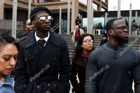Attorney Gloria Schmidt, left, stands with her clients, brothers Olabinjo Osundairo, center, and Abimbola Osundairo, right, as they leave the Leighton Criminal Courthouse in Chicago, where actor Jussie Smollett made an appearance on a new set of charges alleging that he lied to police about being targeted in a racist and homophobic attack in downtown Chicago early last year. The Osundairo brothers claim Smollett hired them to stage an attack on him