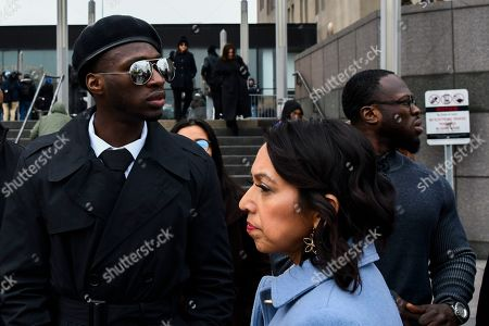Attorney Gloria Schmidt, center, stands with her clients, brothers Olabinjo Osundairo, left, and Abimbola Osundairo, right, as they leave the Leighton Criminal Courthouse in Chicago, where actor Jussie Smollett made an appearance on a new set of charges alleging that he lied to police about being targeted in a racist and homophobic attack in downtown Chicago early last year. The Osundairo brothers claim Smollett hired them to stage an attack on him