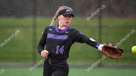Stock Image of Central Arkansas pitcher Jordan Johnson tries to catch a line drive against Morehead State during an NCAA softball game, in Conway, Ark