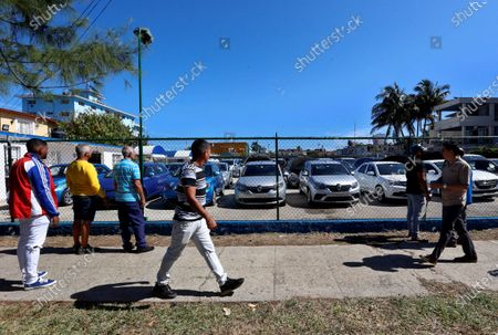 People line up for the purchase of cars at a car sales center in Havana, Cuba, 24 February 2020. The official sales of second-hand cars and in Freely Convertible Currency (MLC) by the Cuban government will begin on Tuesday, February 25.