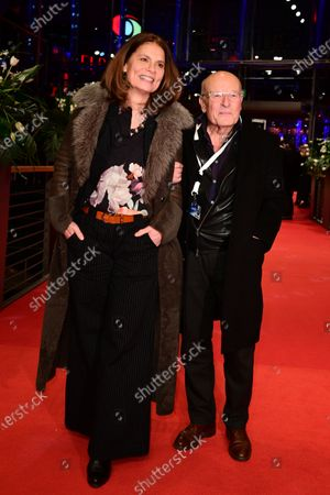 Stock Image of German-Austrian entrepreneur, TV chef, and politician Sarah Wiener (L) and German director Volker Schloendorff (R) arrive for the premiere of 'Schwesterlein' (My Little Sister) during the 70th annual Berlin International Film Festival (Berlinale), in Berlin, Germany, 24 February 2020. The movie is presented in the Official Competition at the Berlinale that runs from 20 February to 01 March 2020.