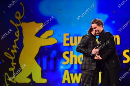 Jonas Dassler from Germany receives an award from German actor Alexander Fehling during the European Shooting Stars 2020 presentation and the premiere of 'Schwesterlein' (My Little Sister) during the 70th annual Berlin International Film Festival (Berlinale), in Berlin, Germany, 24 February 2020. The movie is presented in the Official Competition at the Berlinale that runs from 20 February to 01 March 2020.
