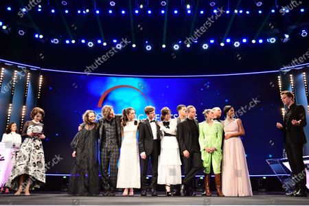 Stock Picture of Alexander Fehling (R) greets actors and actresses of the European Shooting Stars 2020, Ella Rumpf, Bilal Wahib, Victoria Carmen Sonne, Levan Gelbakhiani, Paaru Oja, Bartosz Bielenia, Joana Ribeiro, Jonas Dassler, Zita Hanrot, Martina Apostolova on stage during the European Shooting Stars 2020 presentation and the premiere of 'Schwesterlein' (My Little Sister) during the 70th annual Berlin International Film Festival (Berlinale), in Berlin, Germany, 24 February 2020. The movie is presented in the Official Competition at the Berlinale that runs from 20 February to 01 March 2020.