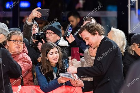 Lars Eidinger signs autographs as he arrives for the premiere of 'Schwesterlein' (My Little Sister) during the 70th annual Berlin International Film Festival (Berlinale), in Berlin, Germany, 24 February 2020. The movie is presented in the Official Competition at the Berlinale that runs from 20 February to 01 March 2020.