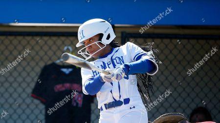 Stock Photo of Mo'ne Davis hits the ball during a Hartford at Hampton NCAA softball game, in Hampton, Va
