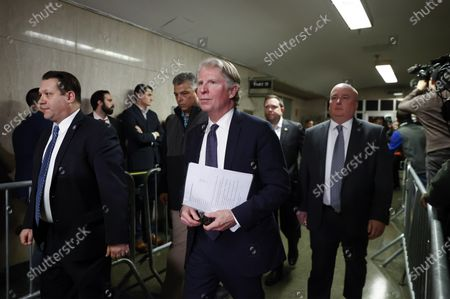 Manhattan District Attorney, Cyrus Vance Jr. leaves the court room flanked by security after former Hollywood producer Harvey Weinstein was found guilty of a felony sex crime and rape, but acquitted of the most serious charges against him, predatory sexual assault at New York State Supreme Court in New York, New York, USA, 24 February 2020. Weinstein was immediately taken into custody and faces up to 25 years in prison when he is sentenced next month.