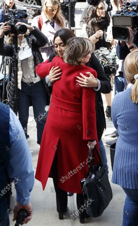 Ambra Gutierrez (Center L), who accused Harvey Weinstein of groping her, embraces attorney Gloria Allred (Center R), who represented three of the six women who testified in Weinstein's criminal trial, after Weinstein was convicted of sexual assault and rape in New York State Supreme Court in New York, New York, USA, 24 February 2020. Weinstein was immediately taken into custody and faces up to 25 years in prison when he is sentenced next month.