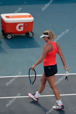 Stock Picture of CoCo Vandeweghe of the U.S. walks off the court to switch her racket after intentionally breaking it, during her Round 1 match agiainst Heather Watson of Great Britain at the Mexican Tennis Open in Acapulco, Mexico