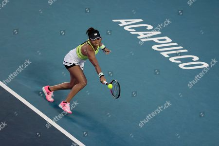 Heather Watson of Great Britain plays a ball in her Round 1 match against CoCo Vandeweghe of the U.S., at the Mexican Tennis Open in Acapulco, Mexico