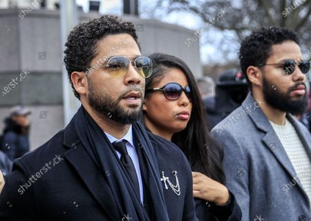 US actor Jussie Smollett (L) leaves the Leighton Criminal Courthouse after pleading not guilty during his arraignment on felony charges of disorderly conduct in Chicago, Illinois, USA, 24 February 2020. Smollett is charged with allegedly filing a false police report over a hate crime attack where he says he was doused with bleach and a noose placed around his neck. Law enforcement officials are convinced he paid two people to attack him in order to further his acting career. A special prosecutor took the case to a grand jury which returned the indictment after original charges were dropped by the state's attorney.