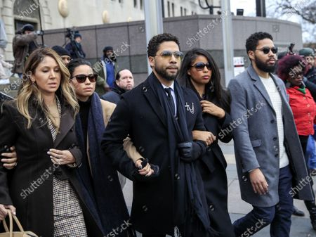 US actor Jussie Smollett (C) leaves the Leighton Criminal Courthouse with attorney Tina Glandian (L) after pleading not guilty during his arraignment on felony charges of disorderly conduct in Chicago, Illinois, USA, 24 February 2020. Smollett is charged with allegedly filing a false police report over a hate crime attack where he says he was doused with bleach and a noose placed around his neck. Law enforcement officials are convinced he paid two people to attack him in order to further his acting career. A special prosecutor took the case to a grand jury which returned the indictment after original charges were dropped by the state's attorney.