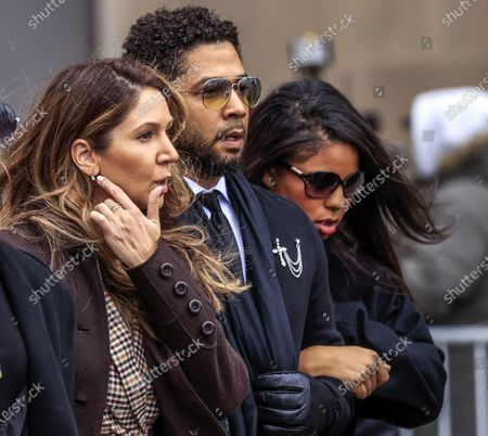 Stock Image of US actor Jussie Smollett (C) leaves the Leighton Criminal Courthouse with attorney Tina Glandian (L) after pleading not guilty during his arraignment on felony charges of disorderly conduct in Chicago, Illinois, USA, 24 February 2020. Smollett is charged with allegedly filing a false police report over a hate crime attack where he says he was doused with bleach and a noose placed around his neck. Law enforcement officials are convinced he paid two people to attack him in order to further his acting career. A special prosecutor took the case to a grand jury which returned the indictment after original charges were dropped by the state's attorney.