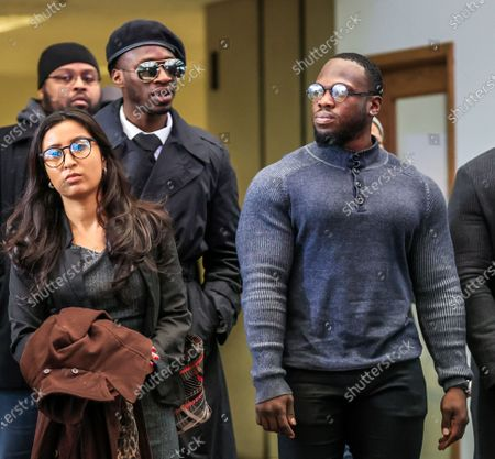 Brothers Abimbola Osundairo (R) and Olabinjo Osundairo (L-in beret), who were said to have been involved in an alleged staged attack on US actor Jussie Smollett, leave the Leighton Criminal Courthouse as Smollett faces new charges stemming from his police reports regarding the alleged attack in January 2019 in Chicago, Illinois, USA, 24 February 2020. Smollett is charged with allegedly filing a false police report over a hate crime attack where he says he was doused with bleach and a noose placed around his neck. Law enforcement officials are convinced he paid two people to attack him in order to further his acting career. A special prosecutor took the case to a grand jury which returned the indictment after original charges were dropped by the state's attorney.