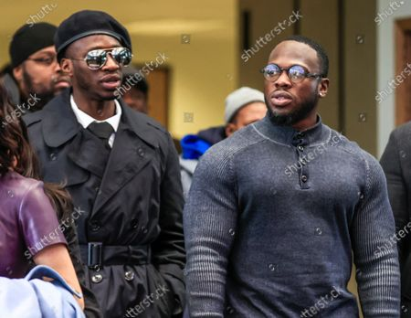 Stock Picture of Brothers Abimbola Osundairo (R) and Olabinjo Osundairo (L-in beret), who were said to have been involved in an alleged staged attack on US actor Jussie Smollett, leave the Leighton Criminal Courthouse as Smollett faces new charges stemming from his police reports regarding the alleged attack in January 2019 in Chicago, Illinois, USA, 24 February 2020. Smollett is charged with allegedly filing a false police report over a hate crime attack where he says he was doused with bleach and a noose placed around his neck. Law enforcement officials are convinced he paid two people to attack him in order to further his acting career. A special prosecutor took the case to a grand jury which returned the indictment after original charges were dropped by the state's attorney.