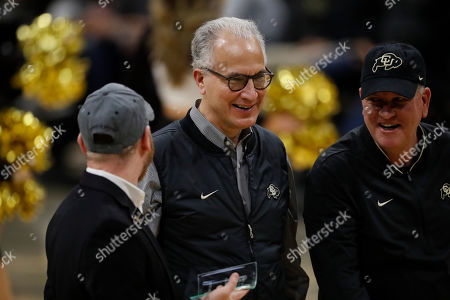 R m. Mark Kennedy, center, president of the University of Colorado, in the first half of an NCAA college basketball game, in Boulder, Colo