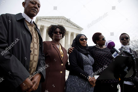 Stock Image of Tibruss Minja, Doreen Oport, Joanne Oport, Rukia Ali, Clara Owino. Family and victims of the 1998 U.S. Embassy bombings, from left Tibruss Minja, Doreen Oport, Rukia Ali, Joanne Oport, and Clara Owino, attend a news conference, outside of the Supreme Court in Washington, following Supreme Court arguments in a case that involves lawsuits against Sudan that accused the country of causing the bombings by aiding al-Qaida and leader Osama bin Laden, who lived in Sudan in the 1990s
