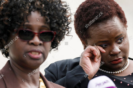 Stock Picture of Doreen Oport, Joanne Oport. Joanne Oport, right, reacts as she listens to her mother Doreen Oport, left, recount her experiences during a news conference, outside of the Supreme Court in Washington, following Supreme Court arguments in a case that involves lawsuits against Sudan that accused the country of causing the bombings by aiding al-Qaida and leader Osama bin Laden, who lived in Sudan in the 1990s