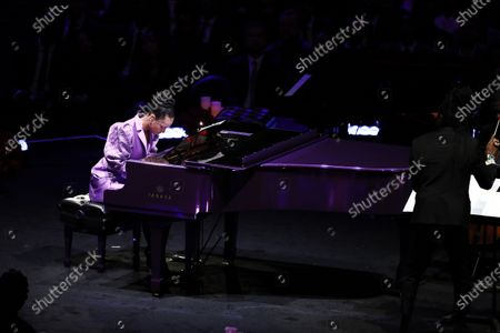 Alicia Keys, American musician plays Beethoven's, 'Moonlight Sonata', one of Kobe and Vanessa Bryant's favorite pieces of music which Kobe learned to play for Vanessa, at to NBA Los Angeles Lakers Kobe Bryant and his daughter, Gianna's memorial service 'A Celebration of Life: Kobe and Gianna Bryant' at Staple Center in Los Angeles, California, USA, 24 February 2020. Bryant, his daughter Gianna 'Gigi' Bryant, Payton Chester, Sarah Chester, Alyssa Altobelli, Keri Altobelli, John Alobelli, Christina Mauser, and helicopter pilot, Ara Zobayan died in helicopter crash in a Calabassas hillside on 26 January.