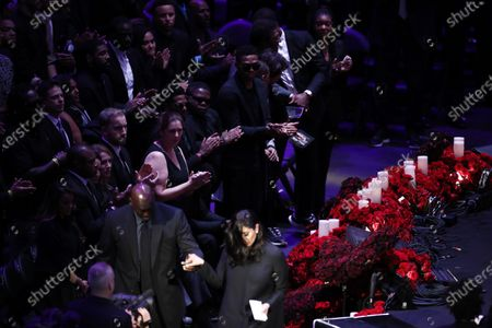 Vanessa Bryant, wife of Kobe Bryant (Bottom-C) is appluaded while being escorted off stage after talking about her husband, Kobe and daughter, Gianna at NBA Los Angeles Lakers Kobe Bryant and his daughter, Gianna's memorial service 'A Celebration of Life: Kobe and Gianna Bryant' at Staple Center in Los Angeles, California, USA, 24 February 2020. Bryant, his daughter Gianna 'Gigi' Bryant, Payton Chester, Sarah Chester, Alyssa Altobelli, Keri Altobelli, John Alobelli, Christina Mauser, and helicopter pilot, Ara Zobayan died in helicopter crash in a Calabassas hillside on 26 January.