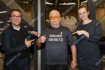 Jan Josef Liefers (L) and Chairwoman of the Commitee of Human Rights and Humanitarian Aid of the German Parliament Gyde Jensen (R) point to former president of Poland and Nobel Peace laureate Lech Walesa (C) wearing a T-shirt reading 'Basic Law' in front of the room for German parliament session prior to the Cinema for Peace Dinner 2020 at the Reichstag building, the seat of the German parliament, in Berlin, Germany, 24 February 2020.
