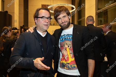 Jan Josef Liefers (L) and Russian-Canadian artist and unofficial spokeperson of Russian band Pussy Riot, Peter Verzilov (R) pose during the Cinema for Peace Dinner 2020 at the Reichstag building, the seat of the German parliament, in Berlin, Germany, 24 February 2020.