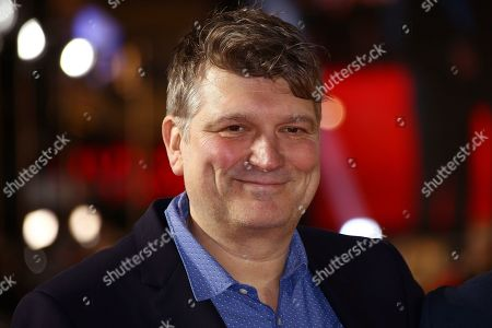 Peter Cattaneo poses for photographers upon arrival at the UK premiere of 'Military Wives' at a central London cinema