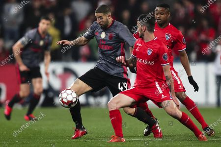 Gil Vicente's Claude Goncalves (R) in action against Benfica's Adel Taarabt (L) during the Portuguese First League soccer match between Gil Vicente and Benfica at Cidade Barcelos stadium, at Barcelos, Portugal, 24 February 2020.