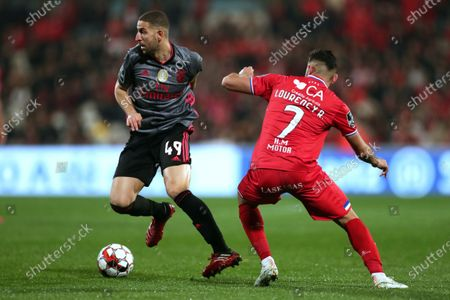Gil Vicente's Lourency (R) in action against Benfica's Adel Taarabt (L) during the Portuguese First League soccer match between Gil Vicente and Benfica at Cidade Barcelos stadium, at Barcelos, Portugal, 24 February 2020.