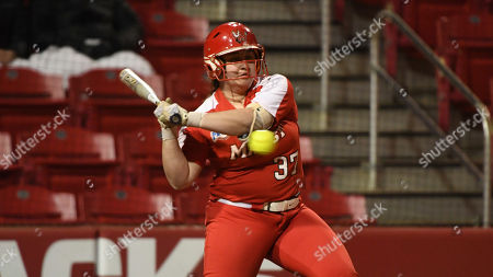 Marist batter Jade Sinskul swings at a pitch against Montana during an NCAA softball game, in Fayetteville, Ark