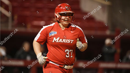 Stock Image of Marist batter Jade Sinskul runs to first base against Montana during an NCAA softball game, in Fayetteville, Ark