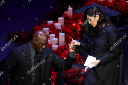 Stock Image of Vanessa Bryant is helped off the stage by former NBA player Michael Jordan after speaking during a celebration of life for her husband Kobe Bryant and daughter Gianna Monday, Feb. 24, 2020, in Los Angeles. (AP Photo/Marcio Jose Sanchez)