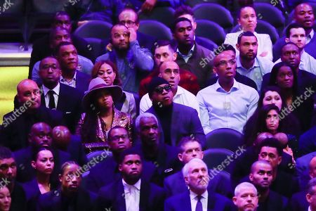 Stock Image of LL Cool J, middle, watches during a celebration of life for Kobe Bryant and his daughter Gianna Monday, Feb. 24, 2020, in Los Angeles. (AP Photo/Marcio Jose Sanchez)