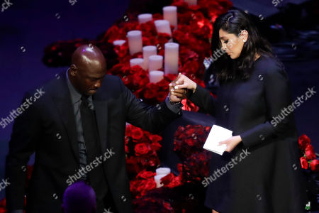 Vanessa Bryant is helped off the stage by former NBA player Michael Jordan after speaking during a celebration of life for her husband Kobe Bryant and daughter Gianna Monday, Feb. 24, 2020, in Los Angeles.