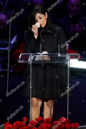 Vanessa Bryant wipes her face after speaking at a celebration of life for her husband Kobe Bryant and daughter Gianna Monday, Feb. 24, 2020, in Los Angeles. (AP Photo/Marcio Jose Sanchez)