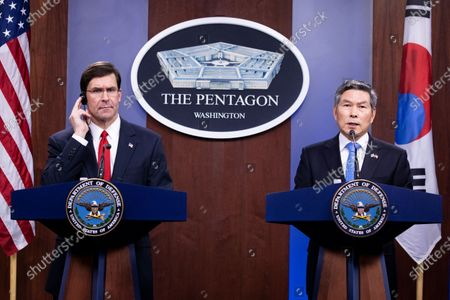 US Secretary of Defense Mark Esper (L) and Minister of National Defense of South Korea Jeong Kyeong-doo (R) hold a joint news conference at the Pentagon in Arlington, Virginia, USA, 24 February 2020. The two meet at the Pentagon to discuss the bilateral cost-sharing deal, known as the Special Measures Agreement, as well as to discuss regional security and policy toward North Korea.