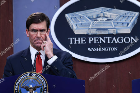 Stock Image of Defense Secretary Mark Esper listens during a news conference with South Korean National Defense Minister Jeong Kyeong-doo at Pentagon in Washington