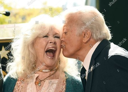 Connie Stevens, Tony Butala. Actress/singer and guest speaker Connie Stevens, left, gets a kiss from Tony Butala, a founding member of pop vocal group The Letterman, after the group received a star on the Hollywood Walk of Fame, in Los Angeles