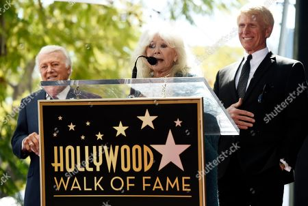 Connie Stevens, Tony Butala, Donovan Tea. Actress/singer Connie Stevens speaks at a ceremony awarding pop vocal group The Lettermen with a star on the Hollywood Walk of Fame, in Los Angeles. Looking on are original Lettermen member Tony Butala, left, and current member Donovan Tea