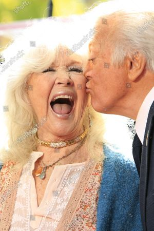Stock Picture of Connie Stevens, Tony Butala at a ceremony honoring The Lettermen with the 2689th star on the Hollywood Walk of Fame in Los Angeles, California, USA, 24 February 2020. The star is dedicated in the category of Music.