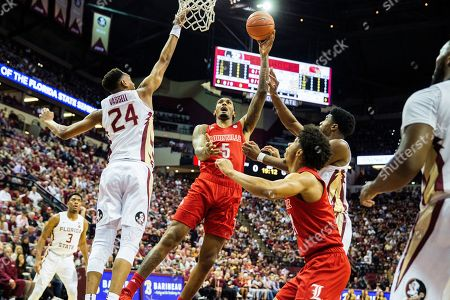 Louisville forward Malik Williams (5) shoots over Florida State guard Devin Vassell (24) in the first half of an NCAA college basketball game in Tallahassee, Fla