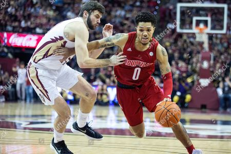 Louisville guard Lamarr Kimble (0) gets past Florida State center Dominik Olejniczak (15) in the first half of an NCAA college basketball game in Tallahassee, Fla