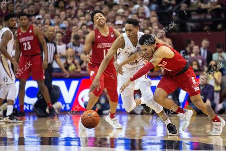 Florida State guard Devin Vassell, second from right, attempts a steal from Louisville guard Lamarr Kimble (0) in the second half of an NCAA college basketball game in Tallahassee, Fla