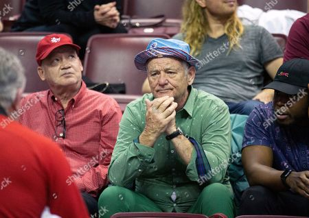 Stock Picture of Actor Bill Murray, center, talks to one of the Louisville staff while his son, Luke Murray, coaches in the second half of an NCAA college basketball game against Florida State in Tallahassee, Fla