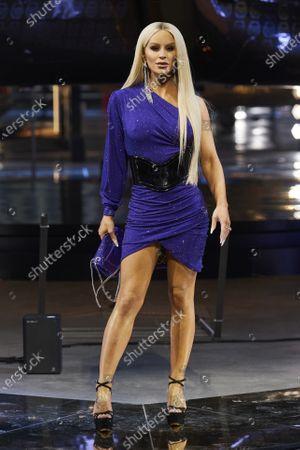 Gigi Gorgeous on the catwalk