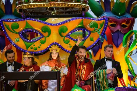 Stock Picture of Singer and actor Harry Connick, Jr., second right, throws beads in the Krewe of Orpheus, a group he co-founded, during Mardi Gras celebrations in New Orleans