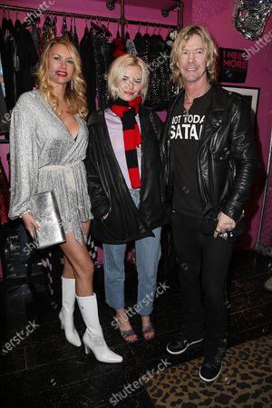 Stock Picture of Susan Holmes McKagan, Grace McKagan and Duff McKagan