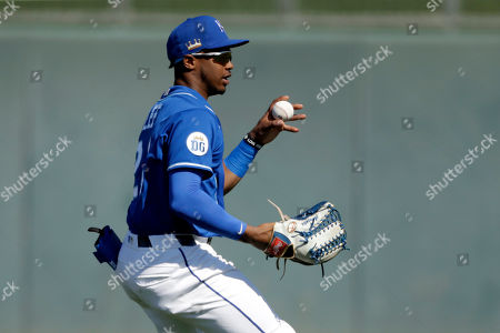 Stock Image of Kansas City Royals left fielder Khalil Lee fields a ball during the third inning of a spring training baseball game against the San Diego Padres, in Surprise, Ariz