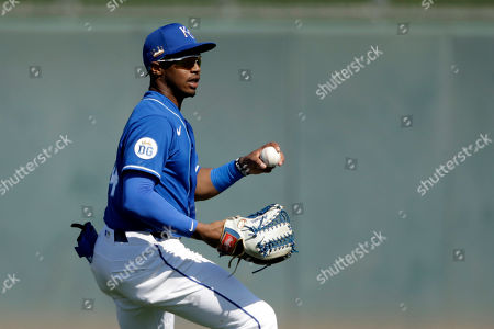 Stock Picture of Kansas City Royals left fielder Khalil Lee fields a ball during the third inning of a spring training baseball game against the San Diego Padres, in Surprise, Ariz