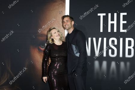 Elisabeth Moss (L) and British actor Oliver Jackson-Cohen (R) arrive for the premiere of the film 'The Invisible Man' at the TCL Chinese Theatre IMAX in Hollywood, California, USA, 24 February 2020. The movie opens in the USA on 28 February 2020.