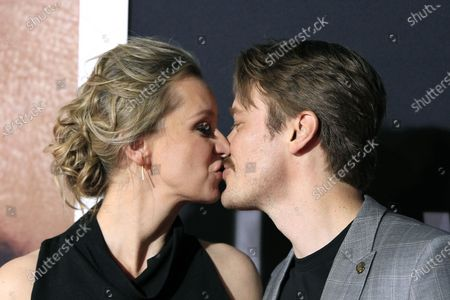Tessa Richardson Dorman (L) kisses her husband New Zealand actor Michael Dorman (R) as they arrive for the premiere of the film 'The Invisible Man' at the TCL Chinese Theatre IMAX in Hollywood, California, USA, 24 February 2020. The movie opens in the USA on 28 February 2020.
